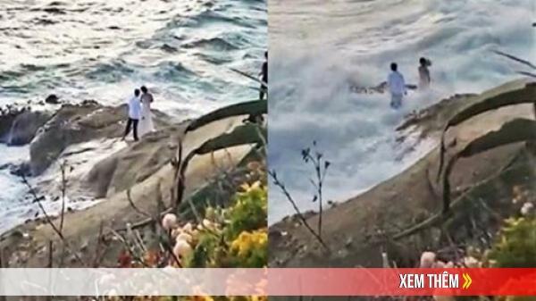 Ra bãi biển chụp ảnh cưới, cô dâu chú rể bị sóng cuốn phăng ra biển, khoảnh khắc con sóng lớn ập đến khiến mọi người thót tim